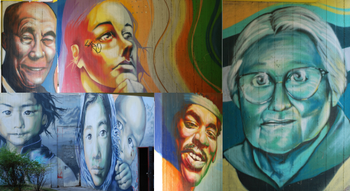 A collage of people's faces of many different ages, genders, and races, painted on walls in rainbow colors.